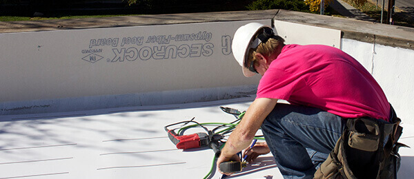 StormForce crew working on a commercial flat roof in Jacksonville, FL.