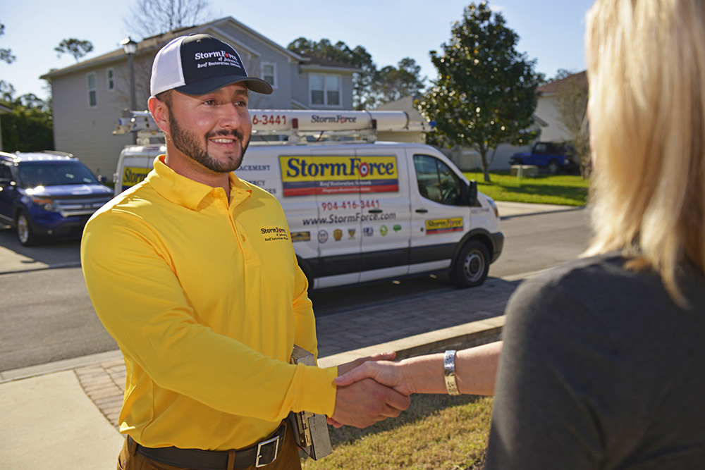 Stormforce Roofing Contractor of Ponte Vedra, FL shaking hands with a homeowner.